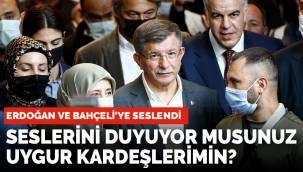 """Davutoğlu, Erdoğan ve Bahçeliye """"Seslerini duyor musunuz Uygur Kardeşlerimin"""" diye sordu."""